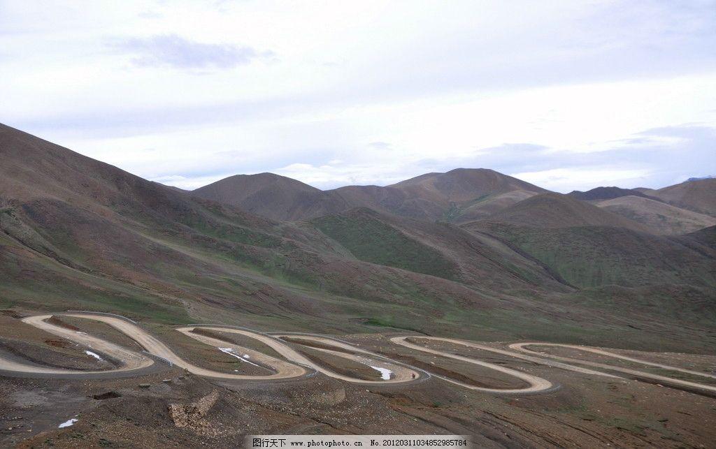 天路之崎岖山路 公路 山峦 草地 摄影 西藏 蓝天 白云 高原 国内旅游